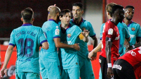 <p>               Barcelona's Lionel Messi, center, celebrates with his teammates after scoring his side's fourth goal during the Spanish La Liga soccer match between Mallorca and FC Barcelona at Son Moix Stadium in Palma de Mallorca, Spain, Saturday, June 13, 2020. With virtual crowds, daily matches and lots of testing for the coronavirus, soccer is coming back to Spain. The Spanish league resumes this week more than three months after it was suspended because of the COVID-19 pandemic. (AP Photo/Francisco Ubilla)             </p>