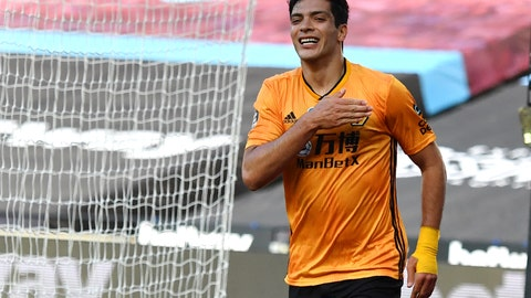 <p>               Wolverhampton Wanderers' Raul Jimenez celebrates after scoring his side's first goal during the English Premier League soccer match between West Ham and Wolverhampton at London stadium in London, England, Saturday, June 20, 2020. (Ben Stansall/Pool via AP)             </p>
