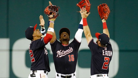 """<p>               FILE - In this June 4, 2019, file photo, Washington Nationals outfielders Juan Soto, from left, Victor Robles and Adam Eaton celebrate after beating the Chicago White Sox 9-5 in an interleague baseball game in Washington. For the 2019 Nationals, Game No. 60 on June 4, 2019, served as something of a microcosm of the whole season and an example of their """"Stay in the fight"""" mindset instilled by manager Dave Martinez. (AP Photo/Patrick Semansky, File)             </p>"""