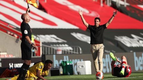 <p>               Arsenal's head coach Mikel Arteta, right, gestures against linesman during the English Premier League soccer match between Southampton and Arsenal at St Mary's Stadium, in Southampton, England, Thursday, June 25, 2020. (Andrew Matthews/Pool via AP)             </p>