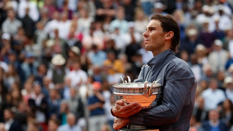 <p>               FILE - In this June 9, 2019, file photo, Spain's Rafael Nadal celebrates his record 12th French Open tennis tournament title after winning the men's final against Austria's Dominic Thiem at Roland Garros stadium in Paris. If not for the coronavirus pandemic, the second week of the French Open this week would have had fourth-round matches, quarterfinals, semifinals and the final for men and women. Nadal could have been trying to add to his 12 trophies at Roland Garros. (AP Photo/Christophe Ena, File)             </p>