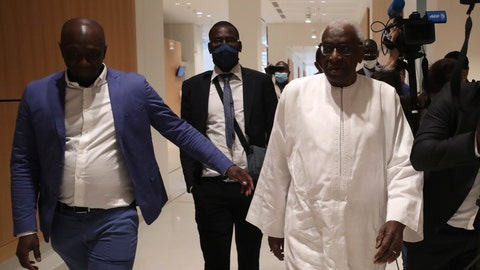 <p>               Former president of the IAAF (International Association of Athletics Federations) Lamine Diack, right, arrives at the Paris courthouse, Wednesday, June 10, 2020. A sweeping sports corruption trial opened Monday in Paris involving allegations of a massive doping cover-up that reached to the top of world track and field's governing body. Lamine Diack, 87, who served as president of the body for nearly 16 years, is among those accused of receiving money from Russian athletes to hide their suspected doping so they could compete at the Olympics in 2012 and other competitions. (AP Photo/Thibault Camus)             </p>