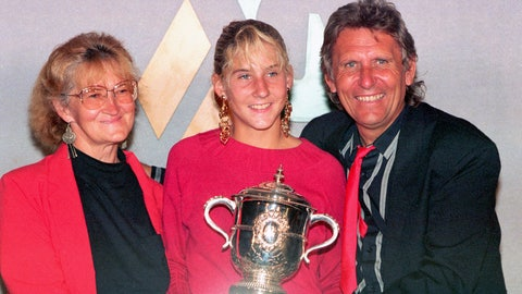 <p>               FILE - In this June 10, 1990, file photo, Monica Seles holds her trophy while posing with her parents Esther and Karoli after winning the French Open championship against Steffi Graf at Roland Garros stadium in Paris. (AP Photo/Lionel Cironneau)             </p>