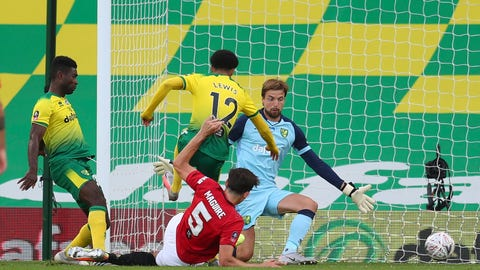 <p>               Manchester United's Harry Maguire scores his side's second goal during the FA Cup sixth round soccer match between Norwich City and Manchester United at Carrow Road stadium in Norwich, England, Saturday, June 27, 2020. (Catherine Ivill/Pool via AP)             </p>