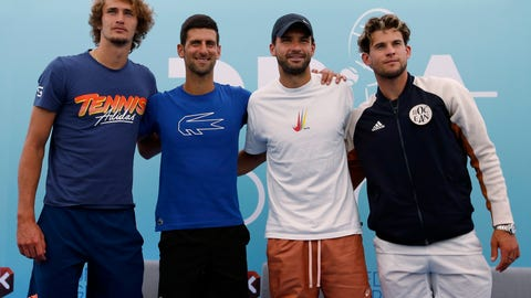 <p>               FILE - In this Friday June 12, 2020 file photo Serbia's Novak Djokovic, second left, poses with Germany's Alexander Zverev, left, Bulgaria's Grigor Dimitrov, second right, and Austria's Dominic Thiem after a press conference prior a a charity tournament Adria Tour, in Belgrade, Serbia. Novak Djokovic has tested positive for the coronavirus after taking part in a tennis exhibition series he organized in Serbia and Croatia. Grigor Dimitrov, a three-time Grand Slam semifinalist from Bulgaria, said Sunday he tested positive. (AP Photo/Darko Vojinovic)             </p>