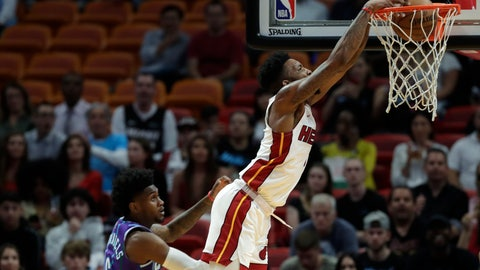 <p>               Miami Heat forward Derrick Jones Jr. dunks the ball against Charlotte Hornets forward Jalen McDaniels (6) during the first half of an NBA basketball game, Wednesday, March 11, 2020, in Miami. (AP Photo/Wilfredo Lee)             </p>
