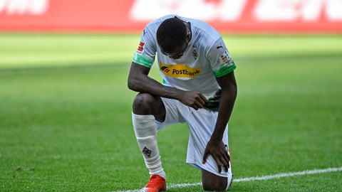 <p>               Moenchengladbach's Marcus Thuram taking the knee after scoring his side's second goal during the German Bundesliga soccer match between Borussia Moenchengladbach and Union Berlin in Moenchengladbach, Germany, Sunday, May 31, 2020. The German Bundesliga becomes the world's first major soccer league to resume after a two-month suspension because of the coronavirus pandemic. (AP Photo/Martin Meissner, Pool)             </p>