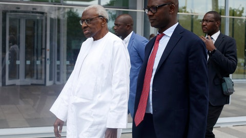 <p>               Former president of the IAAF (International Association of Athletics Federations) Lamine Diack, left, arrives at the Paris courthouse, Wednesday, June 10, 2020. A sweeping sports corruption trial opened Monday in Paris involving allegations of a massive doping cover-up that reached to the top of world track and field's governing body. Lamine Diack, 87, who served as president of the body for nearly 16 years, is among those accused of receiving money from Russian athletes to hide their suspected doping so they could compete at the Olympics in 2012 and other competitions. (AP Photo/Thibault Camus)             </p>