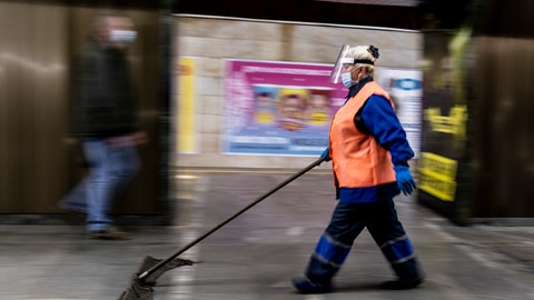 <p>               An employee wearing face masks and gloves to protect against the COVID-19 coronavirus cleans a floor at a subway station in Kyiv, Ukraine on Monday, June 1, 2020. Ukraine continued to ease its coronavirus restrictions Monday, lifting a ban on intercity travel and allowing gyms and swimming pools to reopen. (AP Photo/Evgeniy Maloletka)             </p>