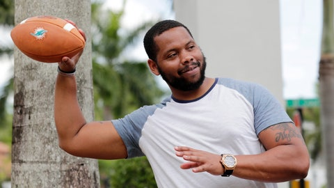 <p>               In this Tuesday, June 16, 2020 photo, D.J. Boldin throws a football outside of his home in Miramar, Fla. Boldin is the football coach at Pahokee High School, a predominantly black school located alongside Lake Okeechobee in Florida. Recent events have given Boldin an opportunity to use his position to prepare his players for the challenges they will face when they leave the bubble that is their small town. (AP Photo/Lynne Sladky)             </p>
