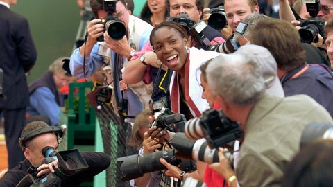 <p>               FILE - In this June 8, 2002, file photo, Venus Williams, surrounded by reporters, smiles after she made a picture of her sister Serena after the women's final of the French Open tennis tournament at Roland Garros stadium in Paris. Serena defeated her sister Venus 7-5, 6-3. (AP Photo/Francois Mori, File)             </p>