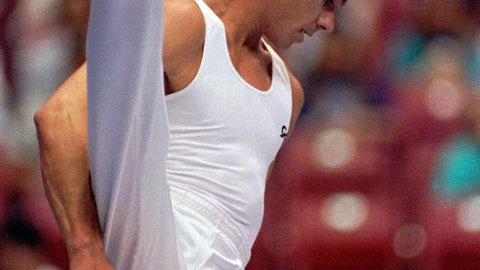 <p>               FILE - In this June 6, 1991, file photo, Kurt Thomas, 35, competes on the pommel horse at the U.S. Gymnastics Championships in the compulsory round in Cincinnati. Thomas, the first U.S. male gymnast to win a world championship gold medal, has died. He was 64. Thomas' family said he died Friday, June 5, 2020. He had a stroke May 24, caused by a tear of the basilar artery in the brain stem. (AP Photo/Michael Snyder, File)             </p>
