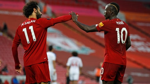 <p>               Liverpool's Sadio Mane, right, celebrates scoring his side's fourth goal with Mo Salah during the English Premier League soccer match between Liverpool and Crystal Palace at Anfield Stadium in Liverpool, England, Wednesday, June 24, 2020. (Phil Noble/Pool via AP)             </p>