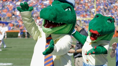 <p>               FILE - In this Nov. 7, 2015, file photo, Albert and Alberta, the mascots for Florida, do the gator chomp before the first half of an NCAA college football game against Vanderbilt in Gainesville, Fla. The University of Florida is ending its 'gator bait' cheer at football games and other sports events because of its racial connotations, the school's president announced Thursday, June 18, 2020, in a letter making several other similar changes on campus. (AP Photo/John Raoux, File)             </p>