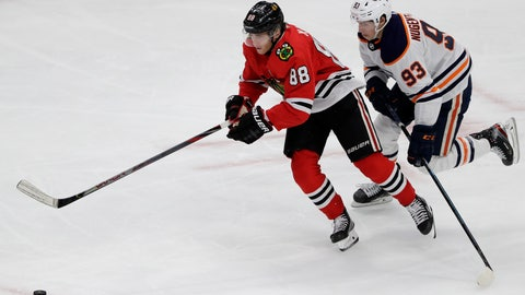 """<p>               FILE - In this March 5, 2020, file photo, Chicago Blackhawks right wing Patrick Kane, left, and Edmonton Oilers center Ryan Nugent-Hopkins chase the puck during the third period of an NHL hockey game in Chicago. Assuming everything goes according to plan and the final details are ironed out between the league and the players' union, the Blackhawks will play the Oilers in a best-of-five qualifier series for the playoff bracket. """"It's been a weird three months,"""" Kane said during a video conference call with reporters. (AP Photo/Nam Y. Huh, File)             </p>"""