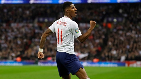 <p>               FILE - In this Thursday, Nov. 14, 2019 file photo England's Marcus Rashford celebrates scoring his side's fourth goal during the Euro 2020 group A qualifying soccer match between England and Montenegro at Wembley stadium in London. British Prime Minister Boris Johnson made an abrupt about-face Tuesday June 16, 2020 and agreed to keep funding meals for needy pupils over the summer holidays, after a campaign headed by young soccer star Marcus Rashford. The Manchester United and England player has been pressing the government not to stop a meal voucher program at the end of the school term in July. (AP Photo/Kirsty Wigglesworth, File)             </p>