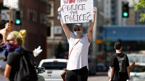 <p>               A demonstrator wears a face mask and latex gloves while waving a placard along Lincoln Avenue during a protest Tuesday, June 2, 2020, in Denver over the death of George Floyd, a handcuffed black man in police custody in Minneapolis. (AP Photo/David Zalubowski)             </p>