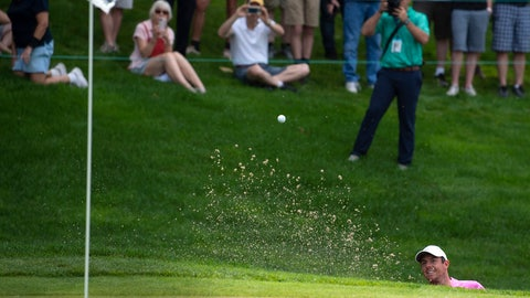 <p>               FILE - In this June 22, 2018, file photo, Rory McIlroy hits out of a bunker on the 18th hole during the second round of the Travelers Championship golf tournament at TPC River Highlands in Cromwell, Conn. The tournament director for this week's Travelers Championship thought about encircling the 18th green at TPC River Highlands with giant video boards that could be filled with images of fans watching the golf and cheering from home. Thursday's, June 25, 2020, tournament will be held without fans, but is still expected to raise significant funds for charity. (Patrick Raycraft/Hartford Courant via AP, File)             </p>