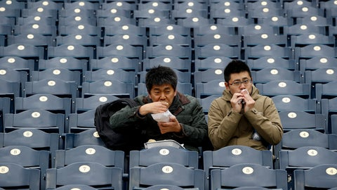 <p>               FILE - In this April 15, 2018, file photo, fans finish their food before exiting Kauffman Stadium after a baseball game between the Kansas City Royals and the Los Angeles Angels was postponed due to inclement weather in Kansas City, Mo. As lock-downs are lifted, restrictions on social gatherings eased and life begins to resemble some sense, sports are finally starting to emerge from the coronavirus pandemic. When stadiums do reopen for fans, how are teams going to drive them through the gate? (AP Photo/Charlie Riedel, File)             </p>