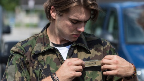 <p>               21 year old Swiss Ice Hockey player Nico Hischier, center at NHL club New Jersey Devils, placed the name tag onto the jacket of the Swiss army uniform he was just issued in Wangen an der Aare, Switzerland, Tuesday, June 16, 2020. Hischier completes part of his mandatory army service for elite athletes with an 18 week recruit training. (Alessandro della Valle/Keystone via AP)             </p>
