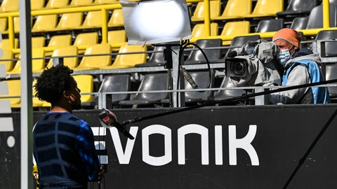 <p>               Schalke's Weston McKennie gives an interview beside the pitch with distance to the camera after the German Bundesliga soccer match between Borussia Dortmund and Schalke 04 in Dortmund, Germany, Saturday, May 16, 2020. The German Bundesliga becomes the world's first major soccer league to resume after a two-month suspension because of the coronavirus pandemic. (AP Photo/Martin Meissner, Pool)             </p>