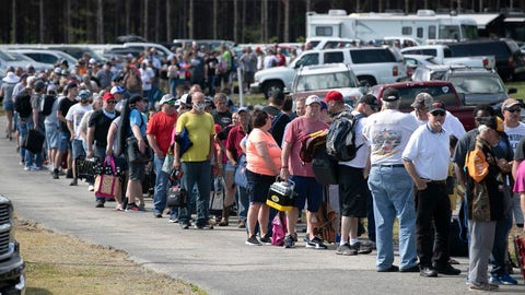 "<p>               In this Saturday, May 23, 2020 photo, hundreds of race fans wait in line to purchase tickets at the Ace Speedway on in the rural Alamance County community of Altamahaw near Elon, N.C. North Carolina Gov. Roy Cooper's administration has ordered closed a small stock-car track that's allowed large crowds to gather repeatedly for weekend races well above COVID-19 limits for mass gatherings. Cooper's health secretary says Ace Speedway in Alamance County is an ""imminent hazard"" for the virus' spread and can't reopen unless it creates a safety plan to keep fans away. (Robert Willett/The News & Observer via AP)             </p>"