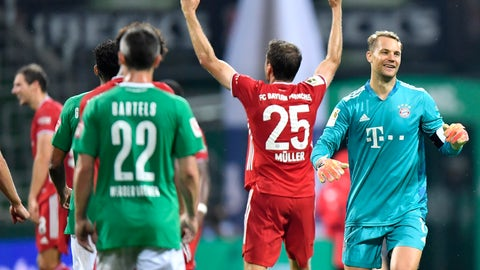 <p>               Bayern's goalkeeper Manuel Neuer, right, and Bayern's Thomas Mueller celebrate end of the German Bundesliga soccer match between Werder Bremen and Bayern Munich in Bremen, Germany, Tuesday, June 16, 2020. Because of the coronavirus outbreak all soccer matches of the German Bundesliga take place without spectators. Bayern Munich secured its eighth successive German Bundesliga title Tuesday with two games to spare after beating Werder Bremen 1-0 with a goal from Robert Lewandowski. (AP Photo/Martin Meissner, Pool)             </p>