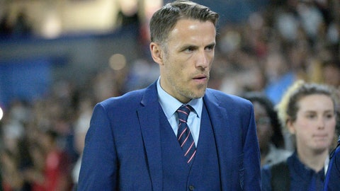 <p>               FILE - In this file photo dated Wednesday, March 7, 2018, England head coach Phil Neville walks onto the field before a SheBelieves Cup women's soccer match against the United States, in Orlando, USA.  Neville will step down from coaching the England women's team when his contract expires next year, it is announced Friday April 24, 2020, missing out on leading the country at the rescheduled European Championship in 2022. (AP Photo/Phelan M. Ebenhack, FILE)             </p>