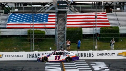 <p>               Denny Hamlin gets the checkered flag as he crosses the finish line to win the NASCAR Cup Series auto race at Pocono Raceway, Sunday, June 28, 2020, in Long Pond, Pa. (AP Photo/Matt Slocum)             </p>