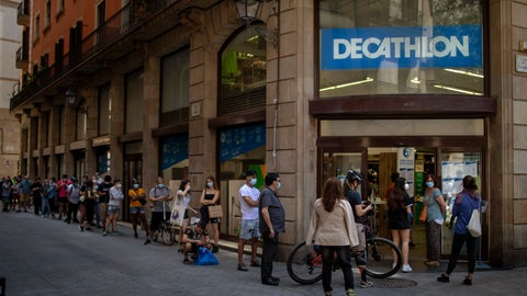 <p>               Customers queue outside a sportswear and equipment store during the coronavirus outbreak in Barcelona, Spain, Thursday, June 4, 2020. (AP Photo/Emilio Morenatti)             </p>