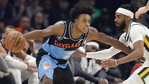 """<p>               FILE - In this March 2, 2020, file photo, Cleveland Cavaliers' Collin Sexton, left, drives past Utah Jazz's Mike Conley in the first half of an NBA basketball game in Cleveland. When Sexton learned that the NBA _ and not a virus _ had ended his second season, the Cavaliers guard had a guttural reaction. """"I was sick,"""" he said. The league's decision to only invite 22 teams to resume play at Disney World in Florida next month was a body blow for players on the omitted squads _ aka the Delete 8. And although they've had time to process the exclusion, Sexton, Cavs star forward Kevin Love and their teammates, are still struggling with the reality that their season is over. (AP Photo/Tony Dejak, File)             </p>"""