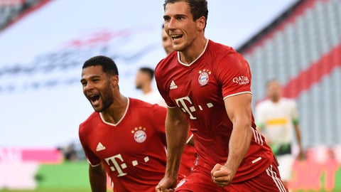 <p>               Bayern's Leon Goretzka, right, celebrates with Serge Gnabry after he scores his side second goal during the German Bundesliga soccer match between Bayern Munich and Borussia Moenchengladbach in Munich, Germany, Saturday, June 13, 2020. Because of the coronavirus outbreak all soccer matches of the German Bundesliga take place without spectators. (Matthias Balk/Pool via AP)             </p>