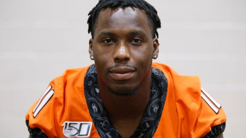<p>               FILE - In this Aug. 3, 2019, file photo, Oklahoma State linebacker Amen Ogbongbemiga poses during an NCAA college football media day in Stillwater Okla. Oklahoma State University officials said Wednesday, June 3, 2020, that  three returning student-athletes have tested positive for COVID-19 although they were not showing symptoms. Among them is OSU linebacker Amen Ogbongbemiga, who said on Twitter he tested positive for the virus after he attended a protest in Tulsa. The 21-year-old Ogbongbemiga says he protected himself during the protest. (AP Photo/Sue Ogrocki, File)             </p>