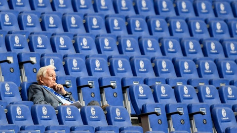 <p>               Schalke's former president Gerd Rehberg sits alone in the tribune during the German Bundesliga soccer match between FC Schalke 04 and VfL Wolfsburg in Gelsenkirchen, Germany, Saturday, June 20, 2020. Because of the coronavirus outbreak all soccer matches of the German Bundesliga take place without spectators. (AP Photo/Martin Meissner, Pool)             </p>
