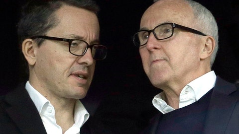 <p>               FILE - In this Sunday, Nov. 20, 2016 file photo, owner of the Olympique de Marseille soccer club, Frank McCourt, right, speaks to Olympique Marseille President Jacques-Henri Eyraud during the League One soccer match between Marseille and Caen, in Marseille, southern France. Marseille must pay UEFA several millions euros (dollars) for breaking rules that monitor club finances but retains its Champions League place. Their place in the Champions League group stage was earned by coach Andre Villas-Boas's team being second to French champion Paris Saint-Germain when the league was ended early during the pandemic. Villas-Boas revived the 1993 European champion after being hired by Frank McCourt, the former Los Angeles Dodgers owner. (AP Photo/Claude Paris, file)             </p>