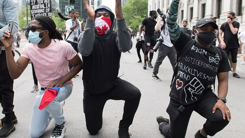 <p>               Protesters take a knee during a demonstration calling for justice for the death of George Floyd and all victims of police brutality, in Montreal, Sunday, June 7, 2020. Floyd died after being restrained by Minneapolis police officers on May 25. (Graham Hughes/The Canadian Press via AP)             </p>