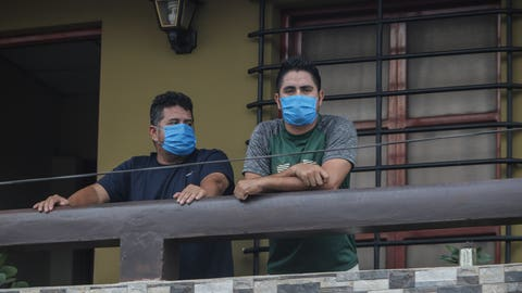 <p>               Norman Cardoze Sr., left, and his son Norman Cardoze Jr. pose for a photo from the balcony of their home where they are in quarantine after catching the new coronavirus in Managua, Nicaragua, Wednesday, May 27, 2020. During a May 16 game, manager Norman Cardoze Sr. and coach Carlos Aranda felt sick. Cardoze's son Norman Jr., the team's star slugger, was so weak and achy he didn't play. Within two days all three men were hospitalized, where the Cardozes spent a week and Aranda died. (AP Photo/Alfredo Zuniga)             </p>