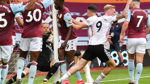 <p>               Aston Villa's Oerjan Nyland saves inside the net during the English Premier League soccer match between Aston Villa and Sheffield United at Villa Park in Birmingham, England, Wednesday, June 17, 2020. The English Premier League resumes Wednesday after its three-month suspension because of the coronavirus outbreak. (Paul Ellis/Pool via AP)             </p>
