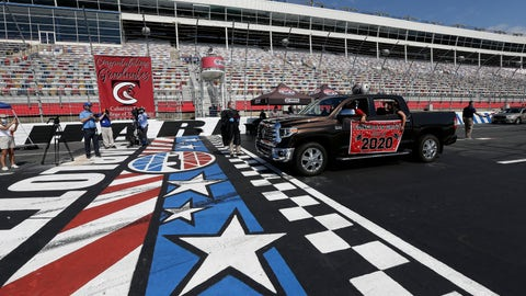 <p>               Class of 2020 graduating seniors from Cabarrus Early College of Technology drive across the start-finish line at the Charlotte Motor Speedway to receive their diplomas during a graduation event in Concord, N.C., Friday, June 12, 2020. Due to the coronavirus pandemic Cabarrus County schools participated in a first-of-its-kind commencement ceremony for it's students and family. (AP Photo/Gerry Broome)             </p>