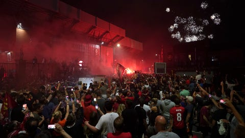 <p>               Liverpool supporters celebrate as they gather outside of Anfield Stadium in Liverpool, England, Thursday, June 25, 2020 after Liverpool clinched the English Premier League title. Liverpool took the title after Manchester City failed to beat Chelsea on Wednesday evening. (AP photo/Jon Super)             </p>
