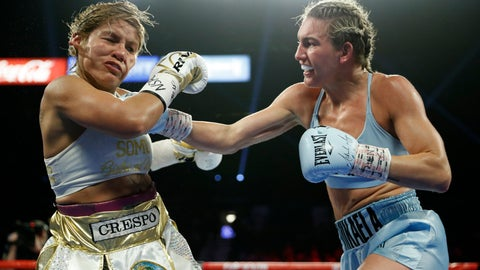 <p>               FILE - In this June 15, 2019, file photo, Mikaela Mayer, right, lands a right to Lizbeth Crespo in a boxing match in Las Vegas. Junior lightweight contender Mayer has tested positive for COVID-19 and has been pulled from the co-main event of Las Vegas' first major boxing card since the start of the coronavirus pandemic. (AP Photo/John Locher, File)             </p>