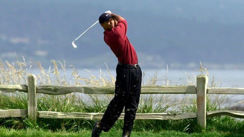 <p>               FILE - In this June 18, 2000, file photo, Tiger Woods tees off on the 18th hole on his way to winning the 100th U.S. Open Golf Championship at the Pebble Beach Golf Links in Pebble Beach, Calif. Golf Channel is airing a one-hour special on May 24 of Woods winning all four majors in a span of 10 months. (AP Photo/Elise Amendola, File)             </p>
