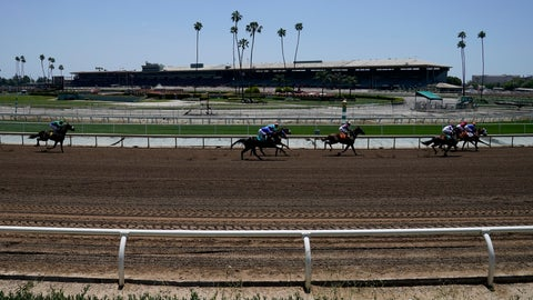 <p>               In this Friday, May 22, 2020 photo, jockeys wearing face masks ride in the first horse race past empty stands at Santa Anita Park in Arcadia, Calif. Horse racing returned to the track after being idled for one and a half months because of public health officials' concerns about the coronavirus pandemic. (AP Photo/Ashley Landis)             </p>