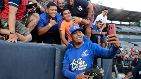 "<p>               FILE - In this Jan. 11, 2020, file photo, Kansas City Royals' Salvador Perez takes a photograph with a fan's cellphone prior to an All-Star exhibition softball game at Rod Carew stadium in Panama City, Panama. When the virus wanes enough to allow the games to begin again, the very essence of these events will likely be missing.  ""You know how much I love to talk to the fans, you know? To be in conversation, to throw the ball to kids,"" Kansas City Royals catcher Salvador Perez said. (AP Photo/Eric Batista, File)             </p>"