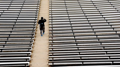 <p>               FILE - In this July 16, 2014, file photo, a student walks through empty seats inside Kenan Stadium at the University of North Carolina in Chapel Hill, N.C., where preparations continue for the upcoming college football season. The crippling grip the coronavirus pandemic has had on the sports world has forced universities, leagues and franchises to evaluate how they might someday welcome back fans. (AP Photo/Gerry Broome, File)             </p>