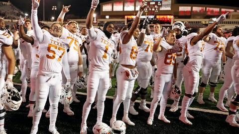 """<p>               FILE - In this Nov. 10, 2018, file photo, Texas players sing """"The Eyes of Texas"""" after an NCAA college football game against Texas Tech in Lubbock, Texas. A group of University of Texas football players and athletes across several sports on Friday, June 12, 2020, urged the school to rename several campus buildings, change the traditional school song and donate a percentage of athletic department revenue to organizations supporting the Black Lives Matter movement. (AP Photo/Brad Tollefson, File)             </p>"""