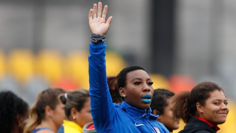 """<p>               FILE - In this Aug. 10, 2019, file photo, Gwendolyn """"Gwen"""" Berry of the United States waves as she is introduced at the start of the women's hammer throw final, during athletics competition at the Pan American Games in Lima, Peru. Berry won the gold medal. The U.S. Olympic and Paralympic Committee is signaling willingness to challenge longstanding IOC rules restricting protests at the Olympics, while also facing backlash from some of its own athletes for moves viewed by some as not being driven by sufficient athlete input. (AP Photo/Rebecca Blackwell, File)             </p>"""
