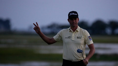 <p>               Webb Simpson waves as the sun disappears on the 18th green, on a course with no fans due to the COVID-19 pandemic, during the final round of the RBC Heritage golf tournament, Sunday, June 21, 2020, in Hilton Head Island, S.C. (AP Photo/Gerry Broome)             </p>