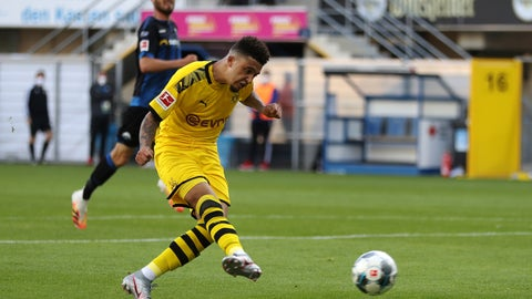 <p>               Jadon Sancho of Borussia Dortmund scores his teams sixth goal during the German Bundesliga soccer match between SC Paderborn 07 and Borussia Dortmund at Benteler Arena in Paderborn, Germany, Sunday, May 31, 2020. Because of the coronavirus outbreak all soccer matches of the German Bundesliga take place without spectators. (Lars Baron/Pool via AP)             </p>