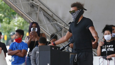 <p>               Atlanta Hawks guard Trae Young, right, speaks during a peaceful rally Monday, June 1, 2020, in his hometown of Norman, Okla., calling attention to the killing of George Floyd by Minneapolis police on May 25. (AP Photo/Sue Ogrocki)             </p>